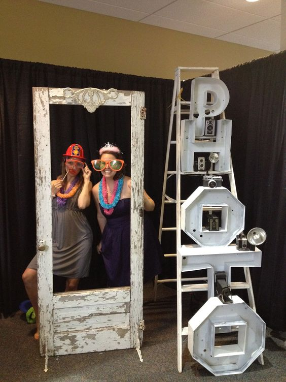 """Photo booth for your next wedding, special event. Old door with chippy white paint, perfect for framing quests photos. Vintage camera's sitting on """"photo"""" for added character!"""