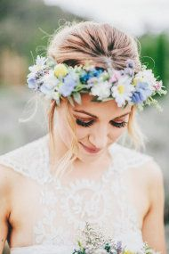 Gorgeous detailing on this wedding dress! Delicate lace is soft and feminine when paired with equally delicate florals. What do you think of the bright pops of color in this flower crown?