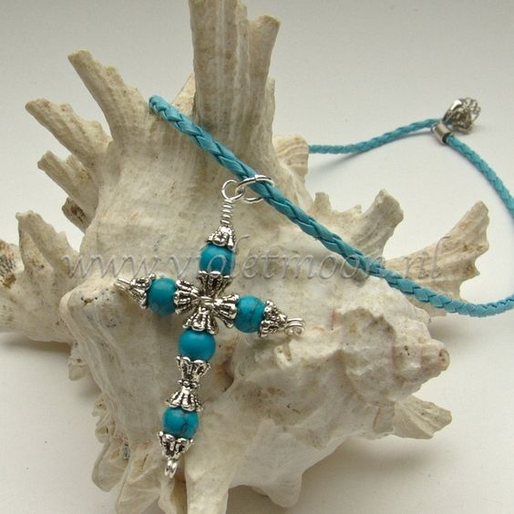 Gemstone cross on a 45 cm long braided leather necklace.: