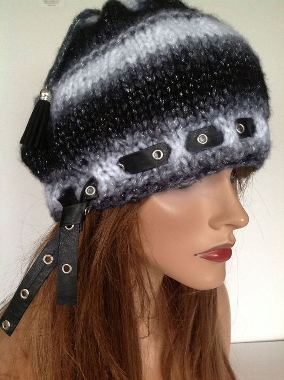 I Designed and Hand Knitted this Beret, Beanie, Slouch Hat.    Isaac Mizrahi Ombre yarn in shades of Black, Gray, Silver and White.    Leather