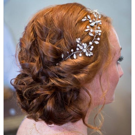 "Another gorgeous look from our friends at Studio Marie Pierre featuring our ""Twyla"" rhinestone bridal hair vine! Romantic elegant curl low side bun bridal hairstyle."
