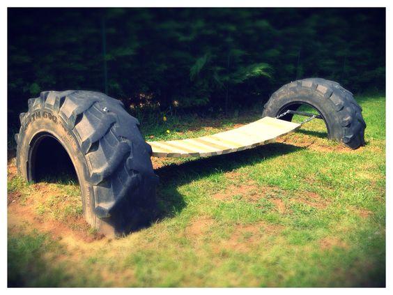 """A suspension bridge made with recycled pallet planksbetween two tractor tires ... Un pont suspendu réalisé avec des planches de palettes entre deux pneus de tracteur... [symple_box color=""""gray"""" fade_in=""""false"""" float=""""center"""" text_align=""""left"""" width=""""100%""""] Submitted by: Tessore Cecile ! [/symple_box]"""