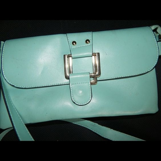 Baby Blue cross body purse Needs to be wiped a little but I used it once only. Comes with a small wristlet strap as well so you can switch. Wear as a cross body, clutch or shoulder bag. Very roomy inside Bags Crossbody Bags
