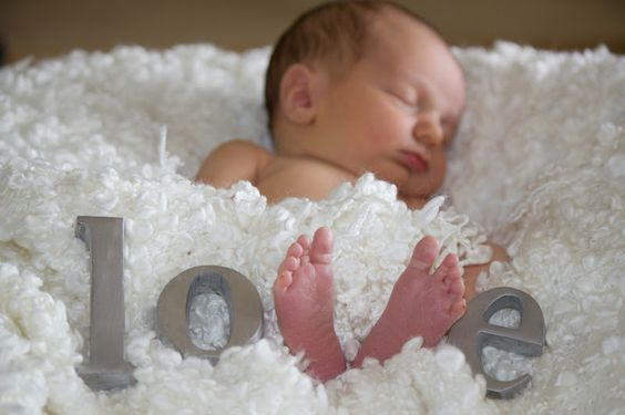 "Newborn Photo Idea--but here's a better one! Have the letters/feet spell out ""evan""!"
