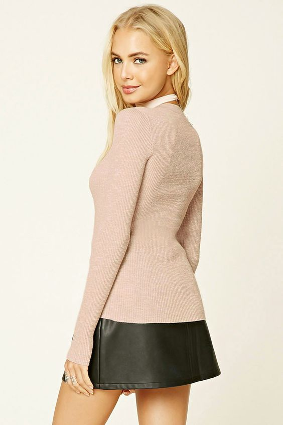 A ribbed marled knit sweater featuring long sleeves, a round neckline, and a form-fitting silhouette.