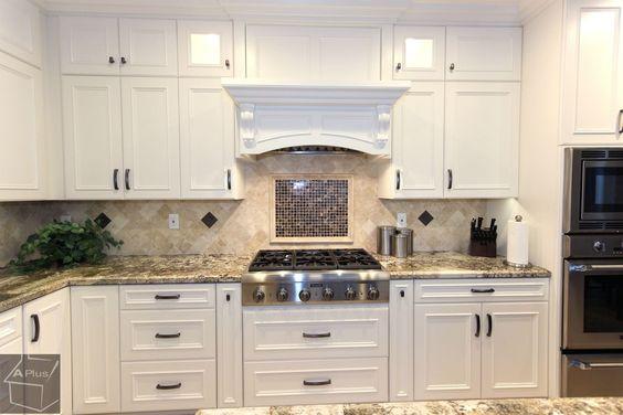 Traditional Kitchen with Kitchen island, Glass panel, U-shaped, Complex granite counters, Limestone Tile, Flush, Custom hood
