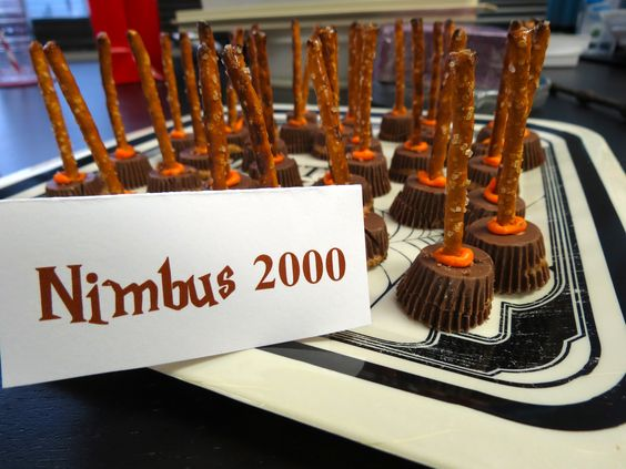 Harry Potter birthday party | Don't forget the Nimbus 2000! Create your own brooms for a Harry Potter themed party with a mini Reeses cup, orange frosting, and a pretzel stick.