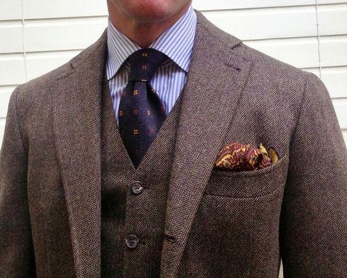 Brown herringbone tweed jacket, white shirt with light blue dress
