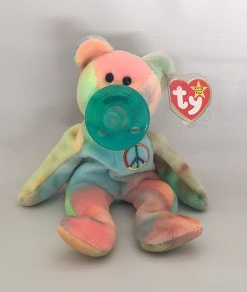 Dootsies Pacifier Lovie TY Beanie Baby Peace Bear  | eBay Like the wubbanub but cheaper and it has the beans in it so the pacifier stays put and doesn't keep falling out! Brilliant!!