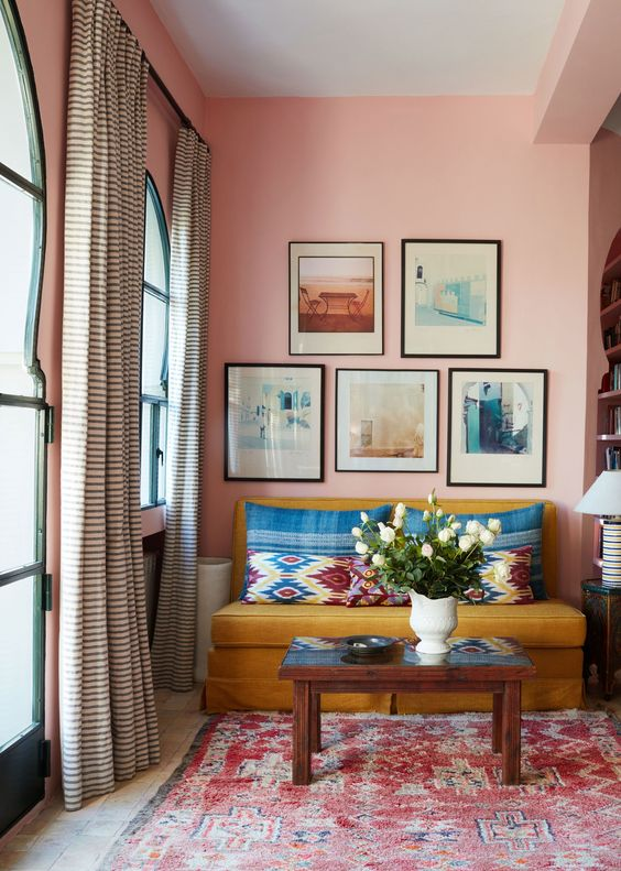 Beautiful pink sitting room with gallery wall in Moroccan house on Thou Swell #morocco #pink #pinkroom #gallerywall #sittingroom #livingroom #interiordesign