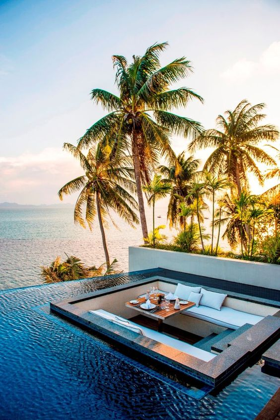 Travel Inspiration for Thailand - Dining surrounded by an infiniti pool at the Conrad Hotel Resort in Koh Samui, Thailand