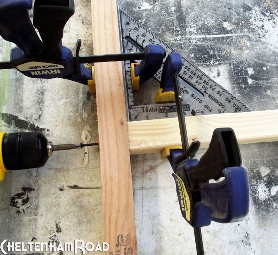 Using a square to clamp a 90degree corner so your hands are free to put screws in