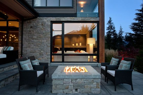 Comfortable seating in front of an outdoor fire pit built-in