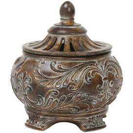 "Canister with an antiqued finish and scrolling details.     Product: Canister Construction Material: Composite wood Color: Brown  Dimensions: 6"" H x 5.5"" Diameter"