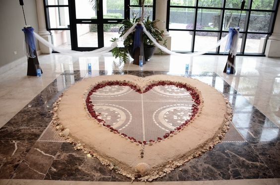Our Mexico wedding was supposed to be a beach wedding, but due to the bad weather forecast the ceremony was moved inside. The wedding coordinators at Ocean Coral & Turquesa surprised us with this huge heart of sand lined with thousands of seashells and hundreds of rose pedals  www.facebook.com/bychameray