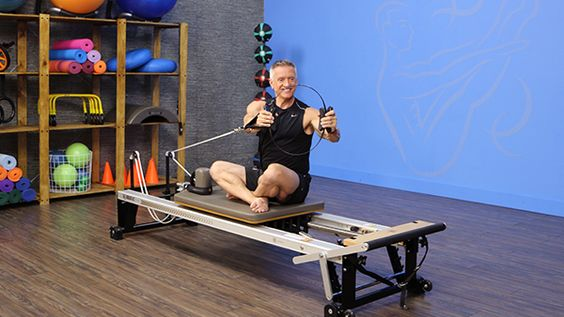 Chest Press with Rotation with the Fitness Circle on the Reformer