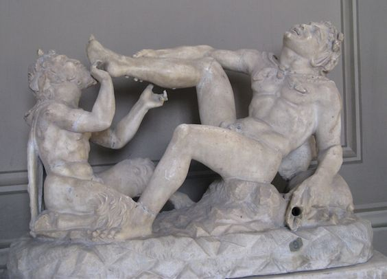 Pan pulling a horn from the foot of a Satyr. Vatican Museums