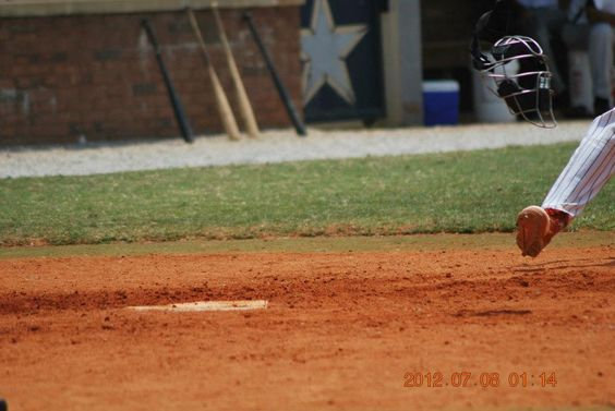 Nico Symington sliding in safe at the Perfect Game Showcase in East, Cobb GA; circa July 2012.