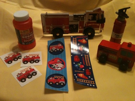 This is what Oren gave in his goodie buckets. Fire truck wooden toy, book, tattoos, stickers, bubbles, and a fire extinguisher.