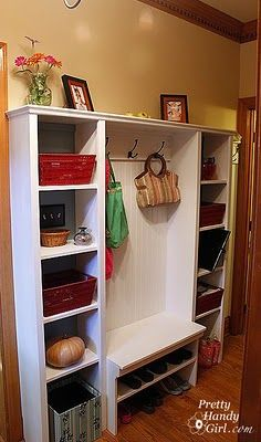 Hallway cube towers and shoe storage -- perfect for the laundry/mudroom, for a tight space.