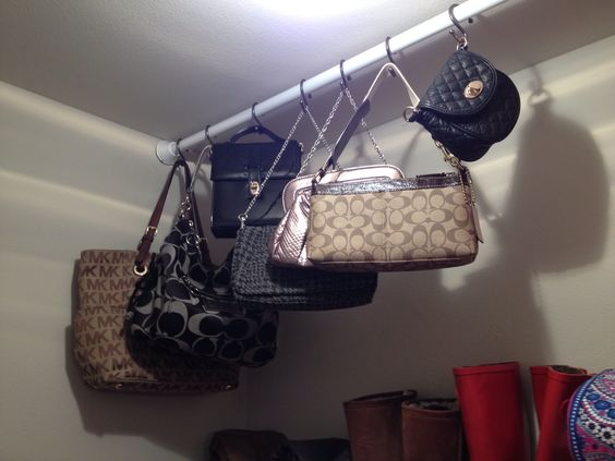 Purse storage using shower curtain rod and S hooks! So functional!: