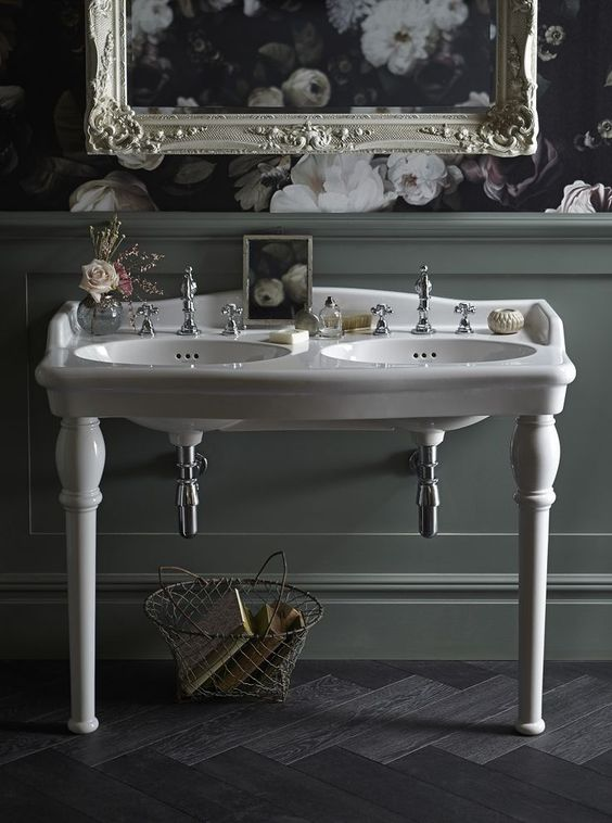 Always personal, that's our approach to creating bathrooms. Be confident in your own sense of style. We love the period drama of this bathroom and romantic opulence of the double console basin with ornate pedestal legs.