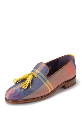 Masterfully constructed with coated leather soles and supple leather lining coated in a rich lilac, the Marcel Tassel Slipper is a well-crafted, vivacious addition to Spring/Summer 2014. The canvas is woven in Vivienne Westwood's signature tartan print using pastel tones which are complemented with tan, piped edging. The shoes are finished with vibrant yellow tassels fastened to the upper.
