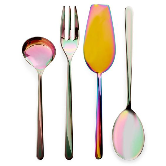 Iridescent Serving UtensilsExclusively at ABC, dreamy waves of color rush over stainless steel Italian-made flatware. Heated to high temperatures in a vacuum chamber, altered metal molecules leave behind the beautiful remnants of their transformation. Gravy Ladle, Serving Fork, Cake Server, and Serving Spoon