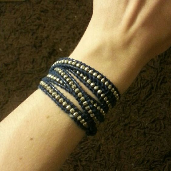 Navy and Silver Wrap Bracelet Wrap bracelet with navy cord and silver beads. In a few places the leather is peeling slightly but it is barely noticeable. Jewelry Bracelets