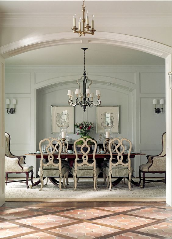French Dining Room. Great paint color and decor in traditional French dining room. French chandelier is by Currey & Co. #French #DiningRoom