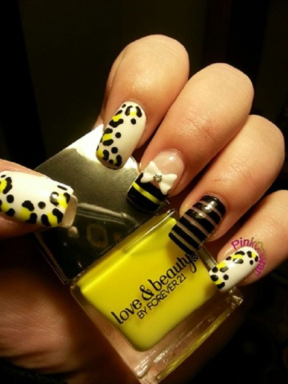 Leopard print bow nail art. There is so much you can do than just simply adding a bow on top.  You can also add stripes and French tips to make it look even better.