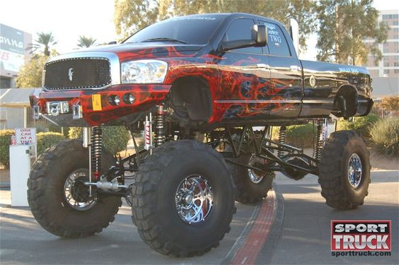 Jacked up newer Dodge at the SEMA show 2009