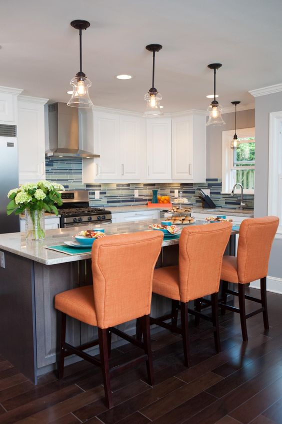 KITCHEN, AFTER: Removing a wall between the kitchen and dining room has created an open concept in this Atlanta home. The gourmet kitchen is equipped with modern appliances and granite countertops and an island that also has room for a breakfast bar.