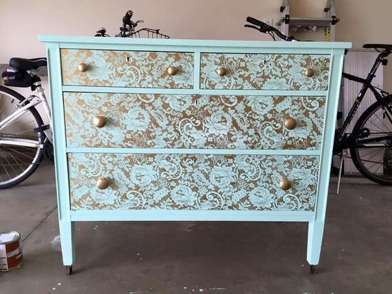 Lay down some lace and spray paint over the face of the drawers to get this look.: