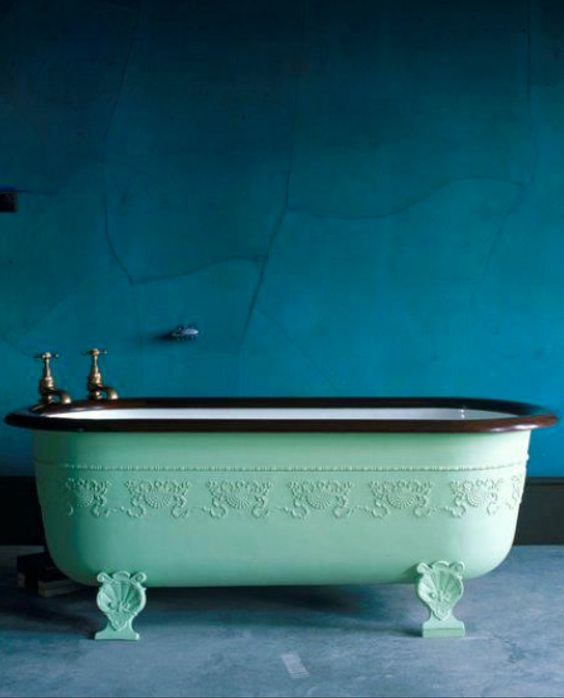 Oh my gosh! An antique bathtub in mint green! So refreshing! I love the rich blue wall too!