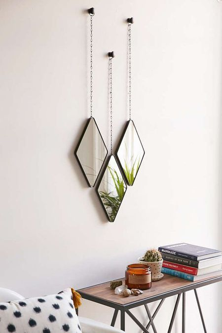 Interior Design: Three small diamond shaped hanging mirrors