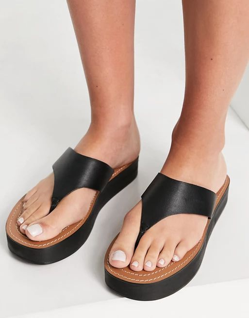 ASOS DESIGN Fuelled chunky leather flipflops in black