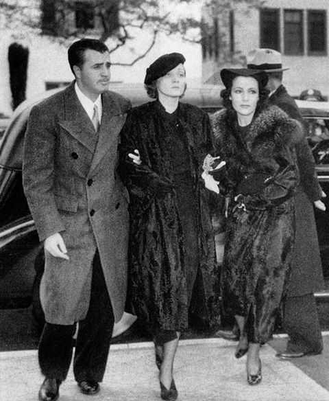 Marlene Dietrich with Dolores Del Rio, arriving at the funeral of her then lover, John Gilbert, in 1936.