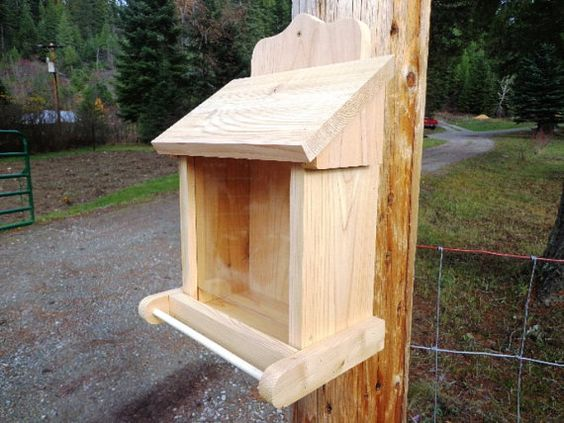 This attractive Cedar Bird Feeder is made using all natural Western Red Cedar which is beautiful as well as naturally decay resistant for many years of service. We use only premium exterior fasteners. The top folds forward for easy refilling and for cleaning. The plexi-glas front slides out for easy cleaning so you will always be able to tell the level of the seeds. A hole is predrilled to hang the feeder on. This is a sturdy and well built feeder that will give you many years of service…