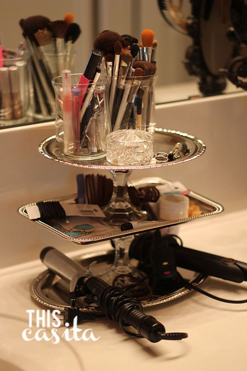 Repurposed trays and candlestick holders make fabulous accessory and make up storage.