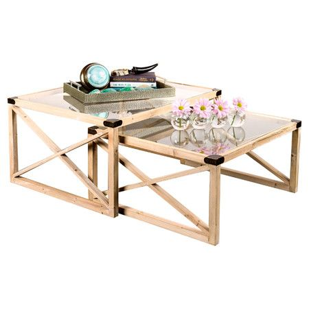 2 wood-framed nesting tables with open x-shaped sides and glass tops.    Product: Small and large nesting tableCons...