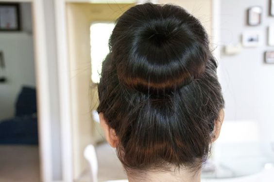 Cheerleader Hair Styles: A High Bun For A Clean Look For Competitions