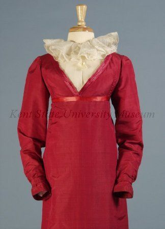 Red faille gown trimmed with satin ca. 1807-1817. The high-waisted neoclassical gowns of the early nineteenth century were not exclusively made of white cottons. The silk faille used in this gown is much stronger than cotton and is lined with linen. The type of fabric and darker color may indicate the use of the gown as a coat-dress, or pelisse, a style that attained great popularity by 1814 but was fastened along the center front. http://www.kent.edu/museum/collection/online-catalogue.cfm