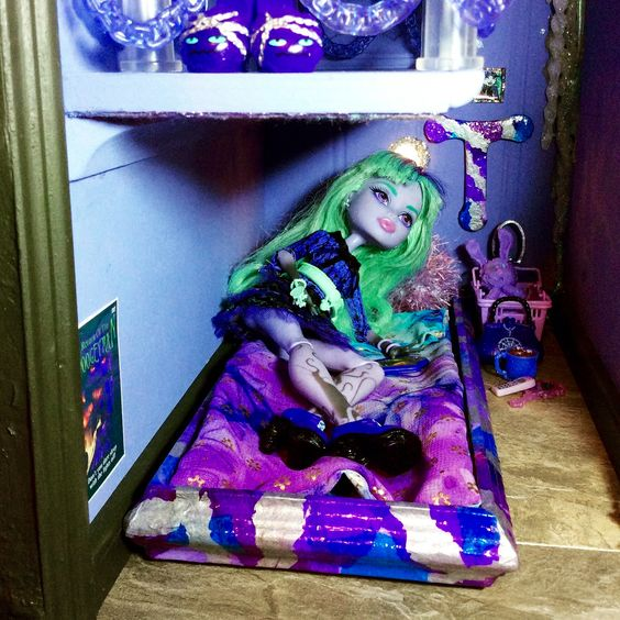 Room 14b Twyla the Monster High doll has her bedroom area in the Purple Room under Spectra's bed right where a boogey man is! Fashioned as an under the bed drawer.  http://www.superbuddiesforever.com/ #monsterhighdollhouse #dollbed