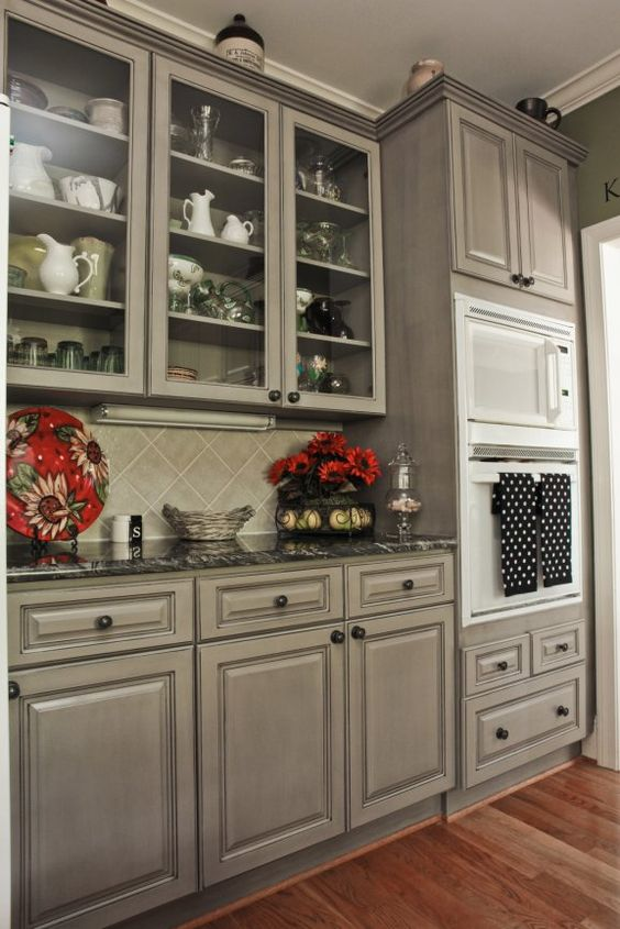 Beautiful Gray cabinets to pliment the black countertops and white applia