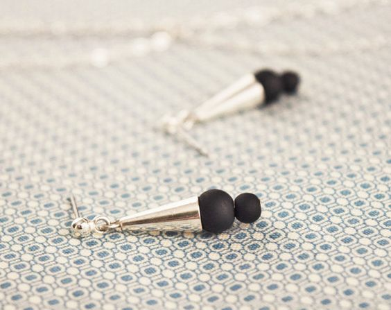 Pendant earrings made with black matte beads and a Sterling Silver Cap. Stainless steel Stud. Hypoallergenic and Handmade.