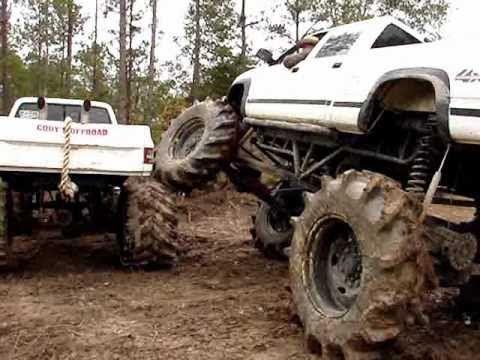 big 4x4 lifted trucks in the mudd huge custom big block