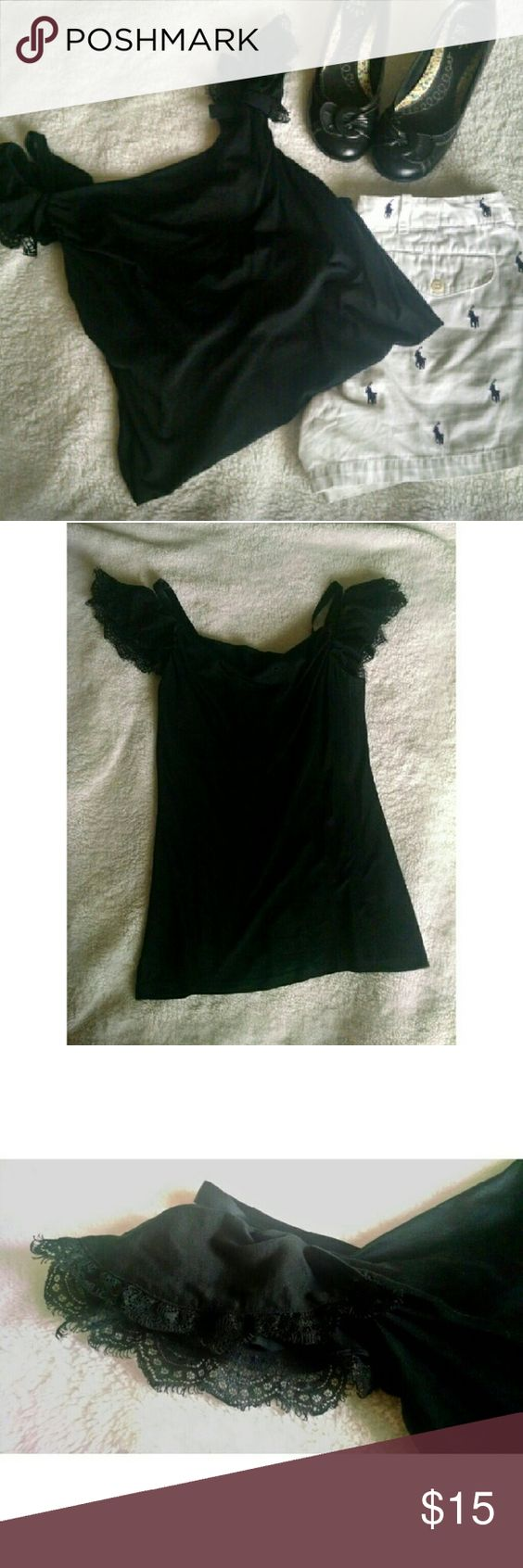 Ralph Lauren Rugby Black Tank Top-Like New Ralph Lauren Rugby Black Tank Top. Only worn once!! Size Small, fits more like an extra small, though it will fit up to a medium. Falls right at hips. It has a cowl neck of sorts, a ribbon shoulder strap with the lace/cloth strap that can stay on the shoulder or hang off the shoulder. No stains rips or tears. Material is 58% Silk, 42% Cotton. Please let me know if you have any questions :)! Ralph Lauren Tops Blouses