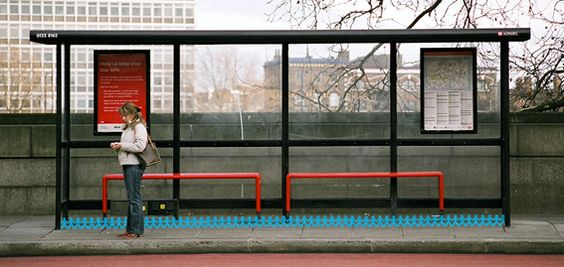 """A """"Humanity"""" paper chain, stretched between the uprights of a bus stop (which, hopefully, the public would step over carefully). [Photograph by Richard Hooker.]"""