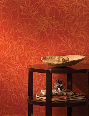 living room wall painted with modern masters sashay red metallic paint and stenciled using royal design